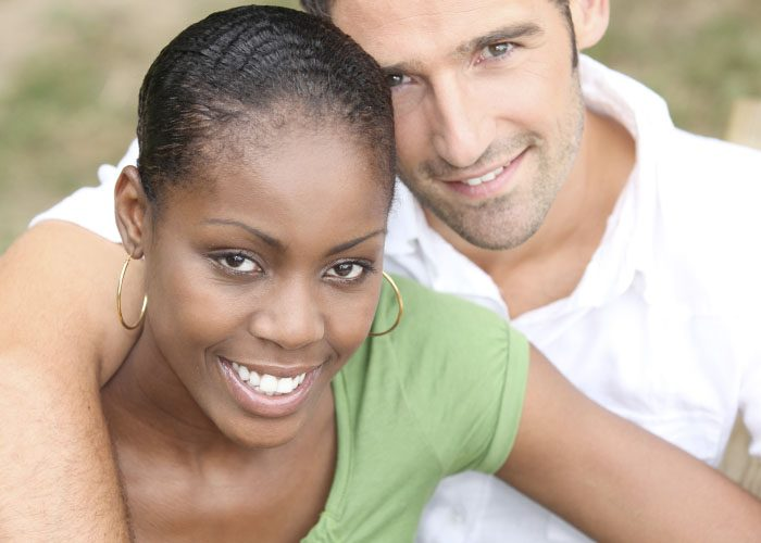 Old white man and young black woman stock photo
